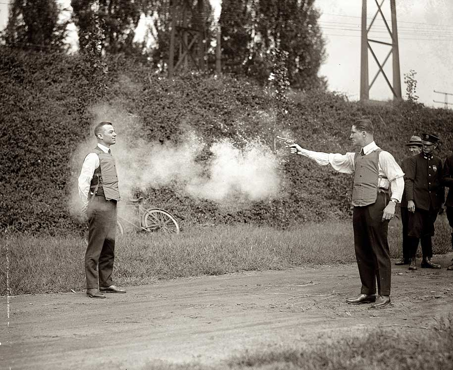 http://www.mobgenic.com/wp-content/uploads/2013/10/W.H.-Murphy-and-his-Associate-Demonstrating-their-Bulletproof-Vest-on-October-13-1923-BW.jpg